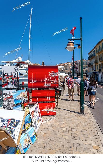Paintings at the promenade Quai Gabriel Peri, Saint-Tropez, Var, Provence-Alpes-Cote d`Azur, France, Europe