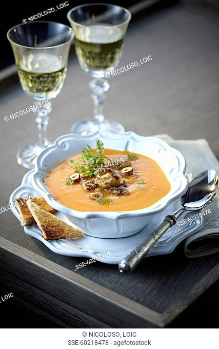 Cream of butternut soup with foie gras and hazelnuts