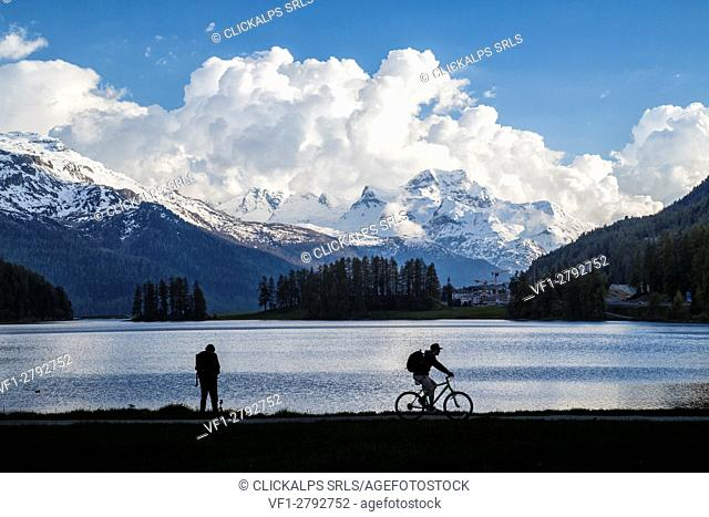 Silhouette of people on the shore of Lake Silvaplana Canton of Graubünden Maloja Engadine Switzerland Europe