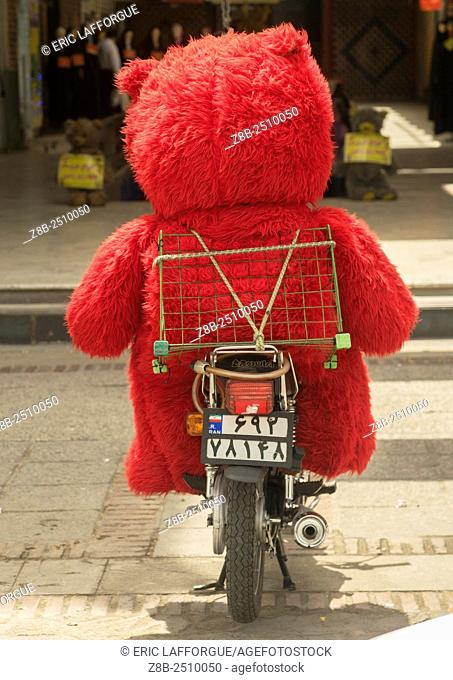 Iran, Fars Province, Shiraz, giant teddy bear on a motorbike