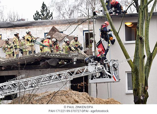 Rescue forces and the height rescue of the fire brigade operate on a house after a scaffolding had fallen in the district of Moabit in Berlin, Germany