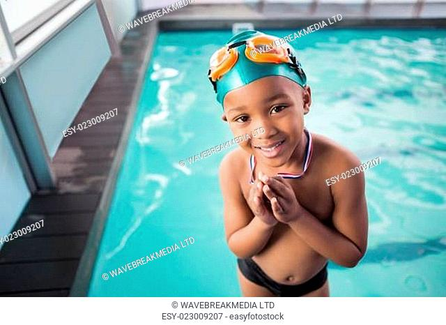 Cute little boy with his medal at the pool