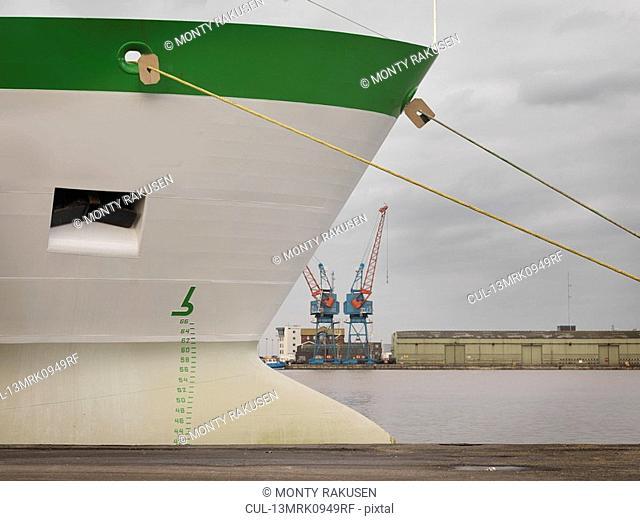 Green & White Ship At Port