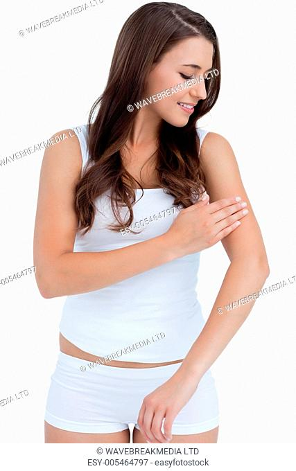 Smiling woman touching her arms