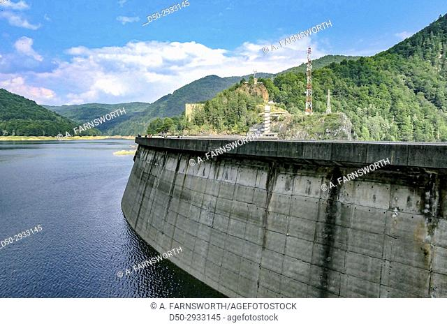 ROMANIA Vidraru Dam is a dam in Romania. It was completed in 1966 on the Arges River and creates Lake Vidraru. The arch dam was built with the primary purpose...