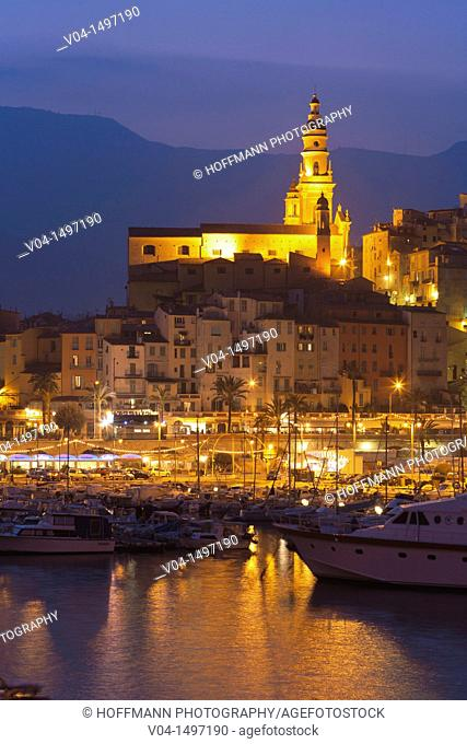 The illuminated Basilique St-Michel-Archange and harbor at dusk, Menton, France, Europe