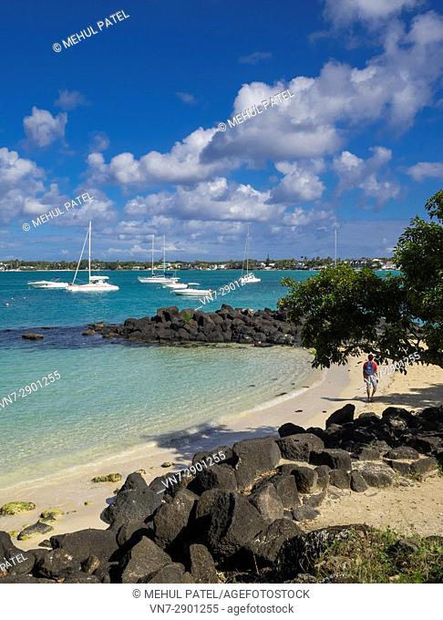 Grand Baie, Mauritius - secluded beach and boats moored in bay. Grand Baie (or Grand Bay) is a seaside village and large tourist beach in the district of...