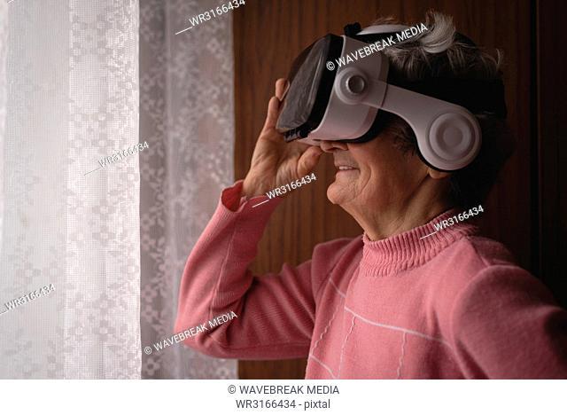 Senior woman using virtual reality headset