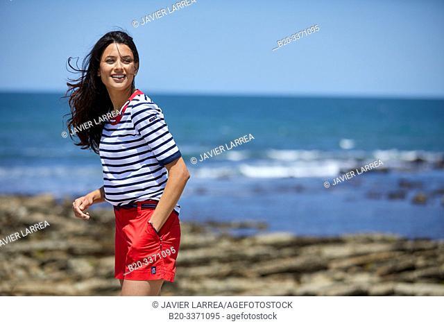Young woman by the sea, Route de La Corniche, Cantabrian Sea Coast, Hendaye, Aquitaine, Basque Country, France