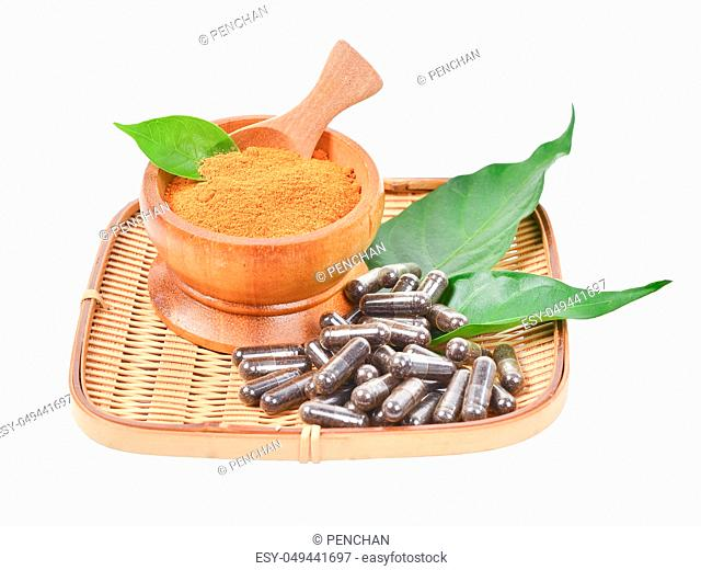Natural medicine capsule pill with black herb, and wooden mortar on white background for alternative medical concept on white background, Save clipping path