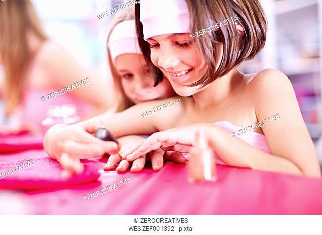 Girl on a beauty farm applying nail polish