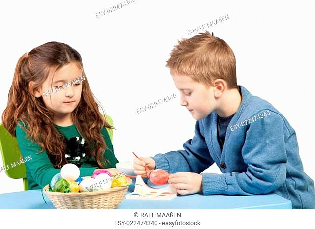 Brother and sister decorating Easter eggs