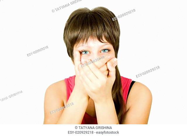 girl closes her mouth with her hands