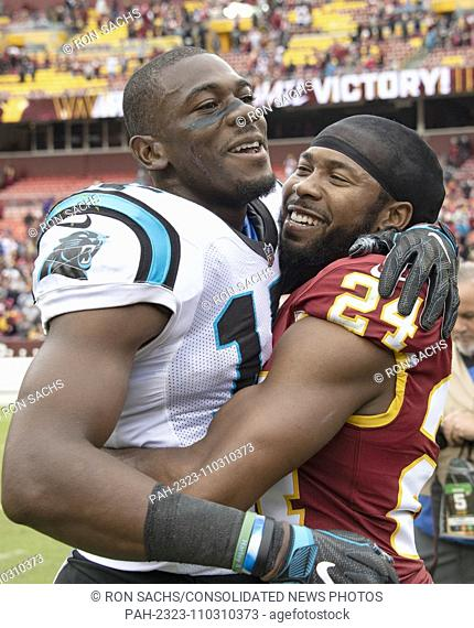 Washington Redskins cornerback Josh Norman (24) hugs his former teammate Carolina Panthers wide receiver Devin Funchess (17) following the game at FedEx Field...