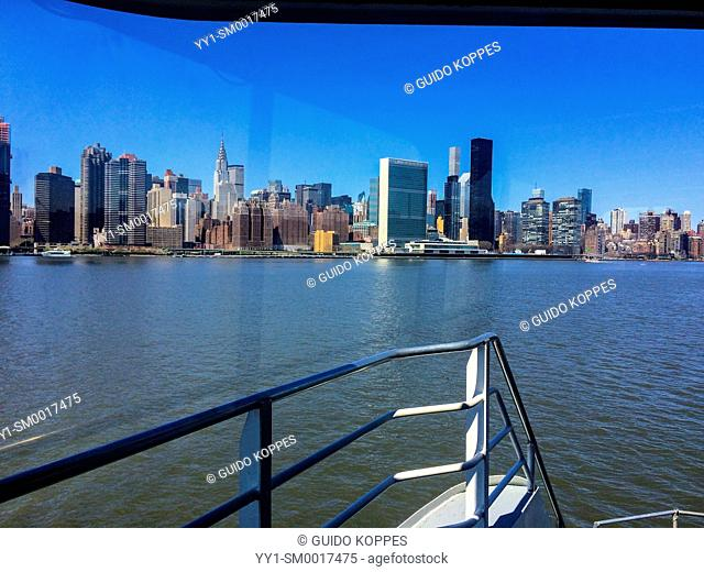 New York, USA. View on Mid Town Manhattan and the United Nations HQ from the East River ferry