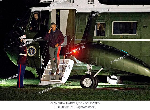 United States President Barack Obama salutes as he walks off Marine One on the South Lawn of the White House in Washington, D.C., U.S., on Monday, Nov