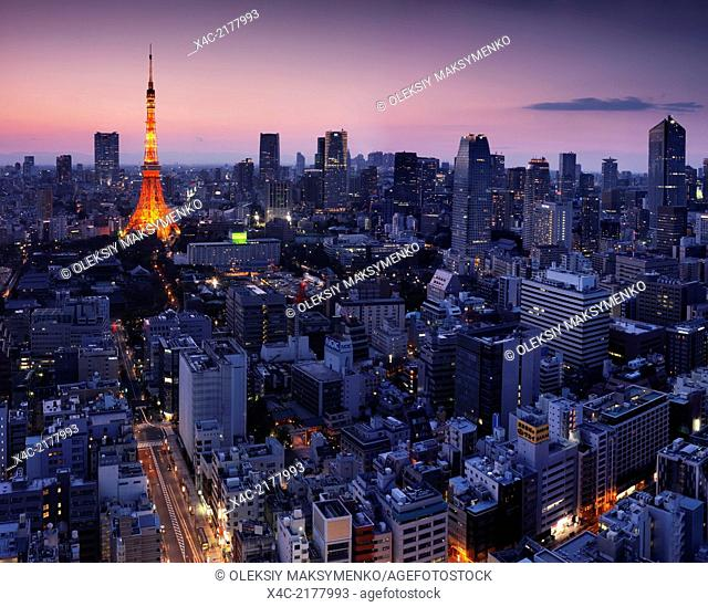 Aerial Tokyo city view with Tokyo tower illuminated in twilight. Minato, Tokyo, Japan