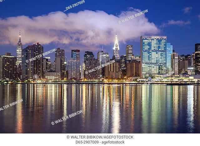 USA, New York, New York City, Long Island City, Mid town Manhattan skyline with UN building, dawn