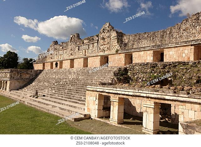 Tourist walking through the ruins, Prehispanic Mayan city of Uxmal Archaeological Site, Yucatan Province, Mexico, North America