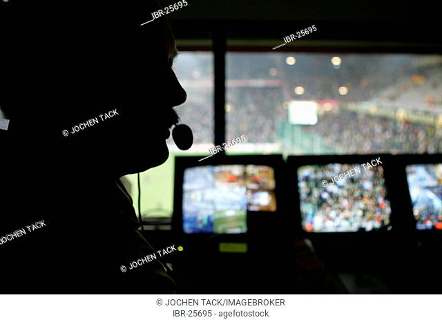 DEU, Germany, Dortmund : Police officers during a football game in the BVB Borussia Dortmund football stadium. Control room