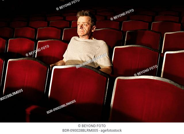 portrait of spectator watching theatre play