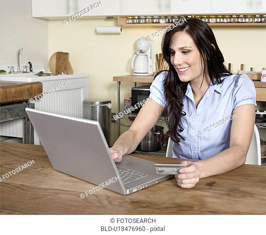 Mid-Adult Woman Shopping Online