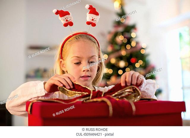 Girl wrapping Christmas presents