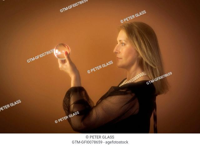 Woman holding a crystal ball