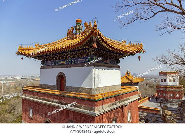 Buddhist temple buildings perched in rocky hillside at the Summer Palace in Beijing, China