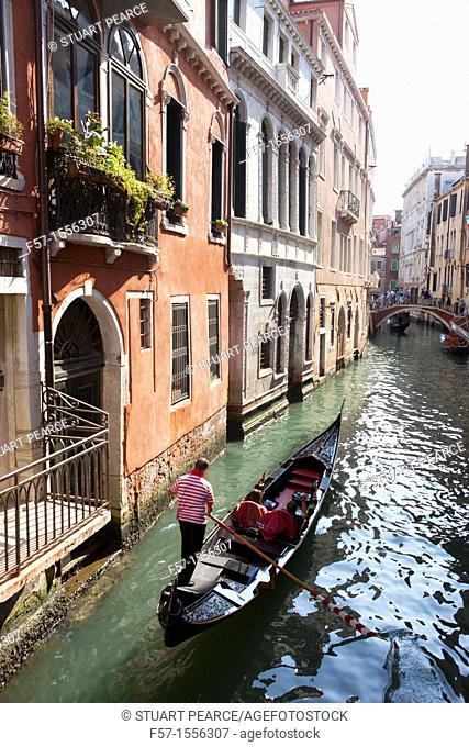 Gondolas on the narrow canals of Venice, Italy