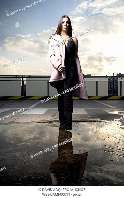 Portrait of fashionable young woman on parking level