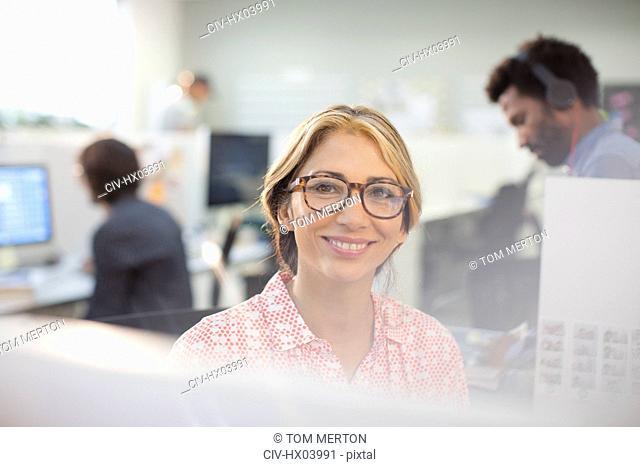 Portrait smiling, confident businesswoman in eyeglasses