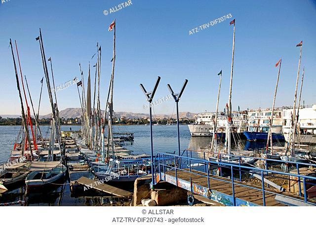 MOORED FELUCCAS & CRUISE SHIPS; RIVER NILE, LUXOR, EGYPT; 13/01/2013