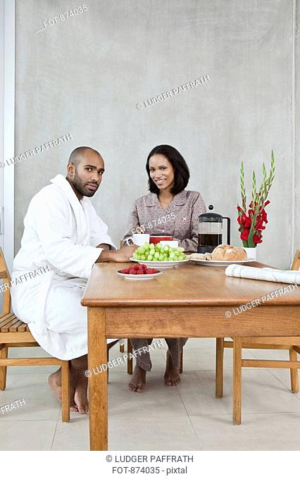 A young couple sitting at a table for breakfast