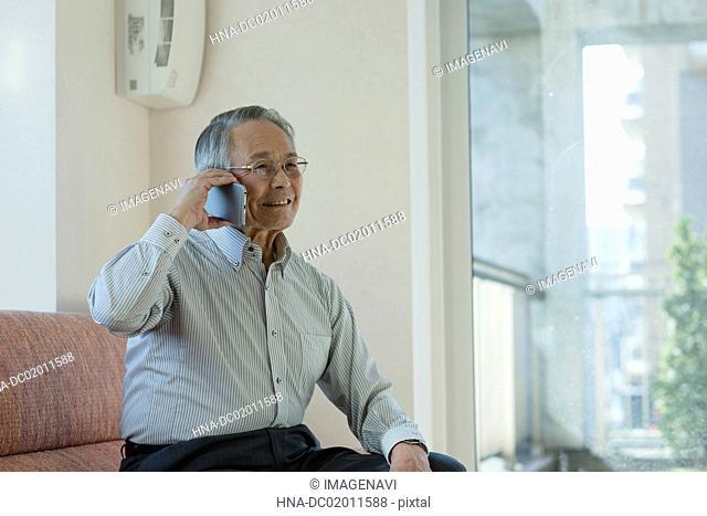 Senior man talking on smart phone