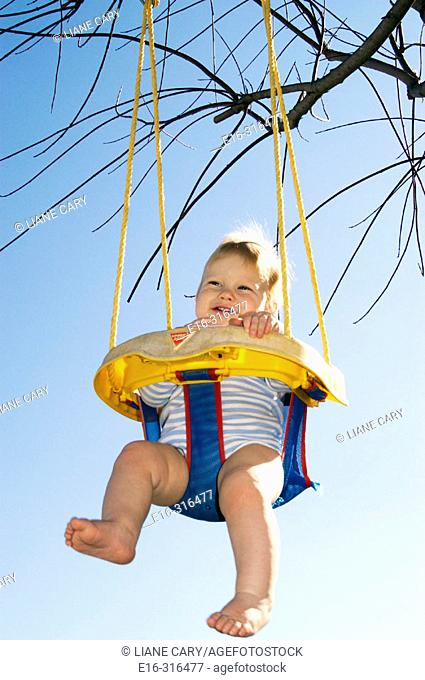 infant on swing