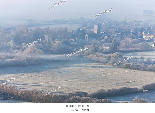 Field near small town in rolling countryside of Somerset, England