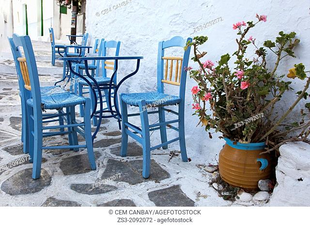 Street scene with blue tables and chairs, Chora, Amorgos, Cyclades Islands, Greek Islands, Greece, Europe