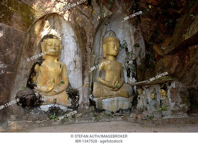 Theravada Buddhism, archeology, ancient golden Buddha figures, relief in rock, Xang Vang, at Ban Phone Savang, Vientiane Province, Laos, Southeast Asia, Asia
