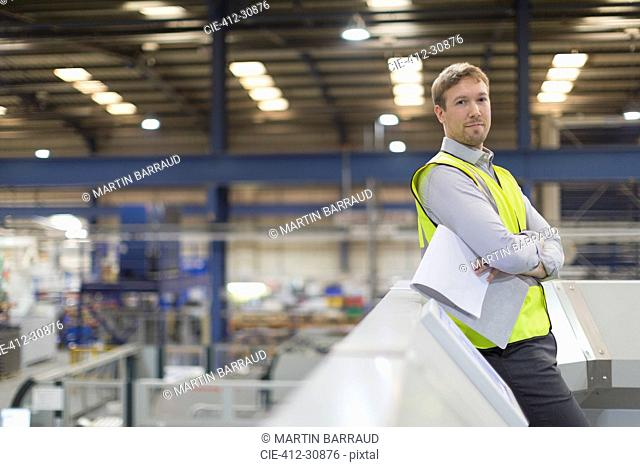 Portrait confident supervisor in steel factory