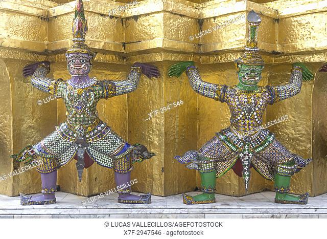 Statues of demons on a Golden Chedi, at the temple of the Emerald Buddha Wat Phra Kaeo, Grand Palace, Bangkok, Thailand