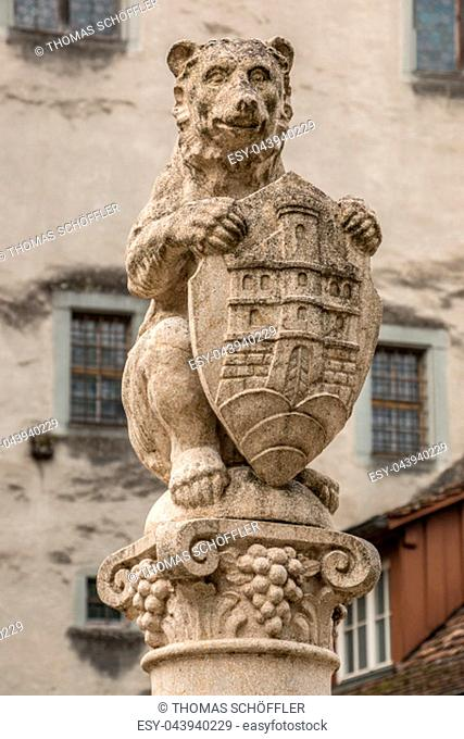 Stone fountain with a bear and a shield