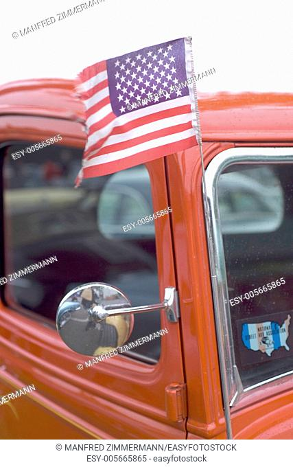 American flag blowing in the Ford pick up