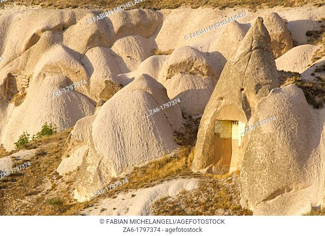 Cave dwellings in Pigeon Valley, near Uchisar, Nevsehir, Cappadocia, Turkey
