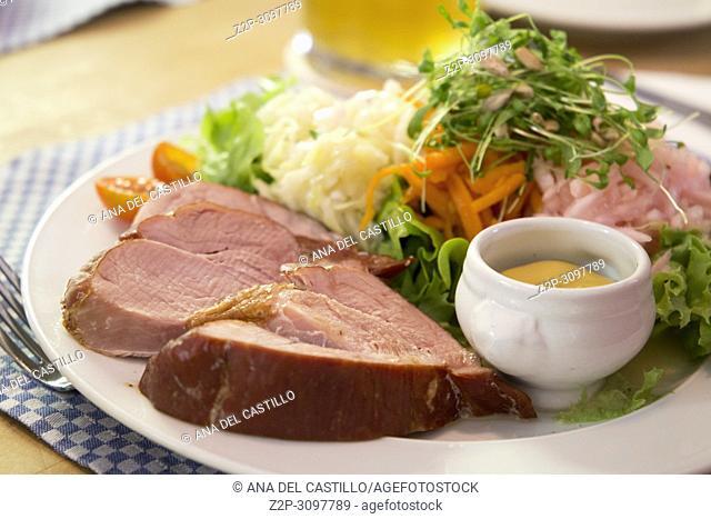 German smoked pork meat with vegetables