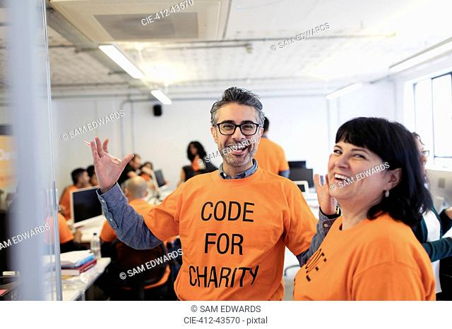 Enthusiastic hackers coding for charity at hackathon