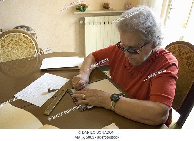 woman reading braille, nembro, italy