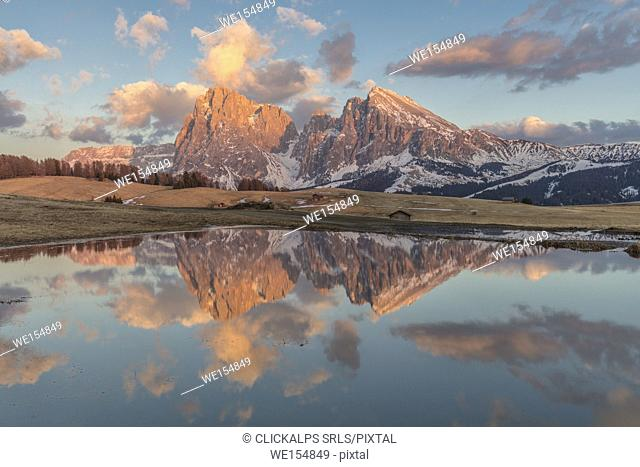 Sunset time in Alpe di Siusi, Sciliar-Catinaccio Nature Park, Trentino Alto Adige, Italy, surrounded by wide meadows and idyllic huts