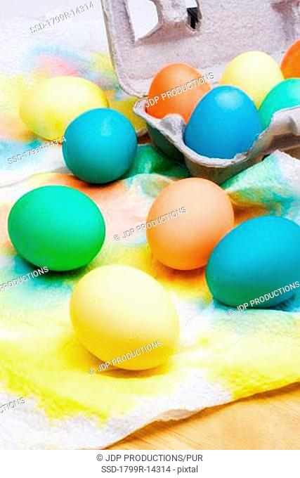 Assorted colorful Easter eggs drying on paper towels