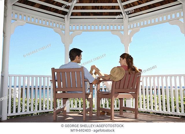 Couple relaxing in a Gazebo